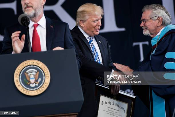 President of Liberty University Jerry Falwell speaks while US President Donald Trump is presented with an honorary doctorate during Liberty...
