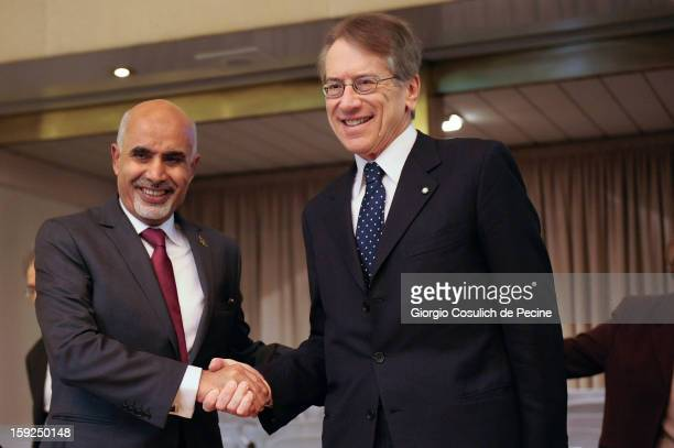 President of Libya's General National Congress Mohamed Yousef elMagariaf shakes hands with Italian Foreign Minister Giulio Terzi prior to a meeting...