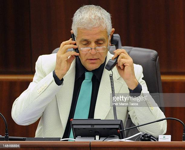 President of Lombardy Regional Assembly Roberto Formigoni speaks on the phone during Lombardy Regional Assembly on July 17 2012 in Milan Italy...