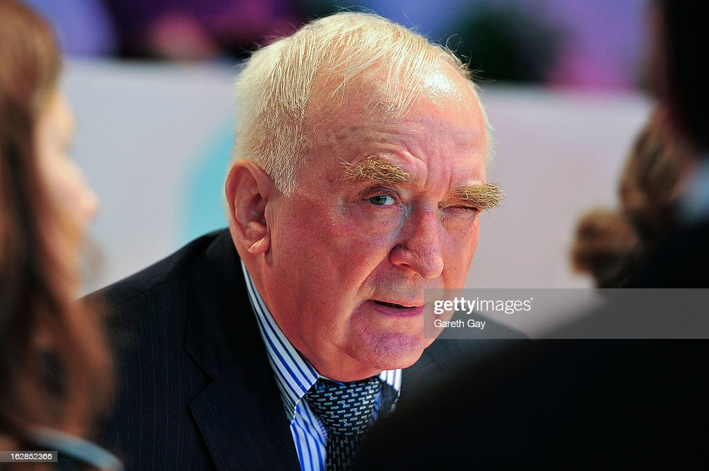 President of Longines Walter Von Kanel talks with guests during the Furusiyya FEI Nations Cup on February 28, 2013 in Hong Kong.
