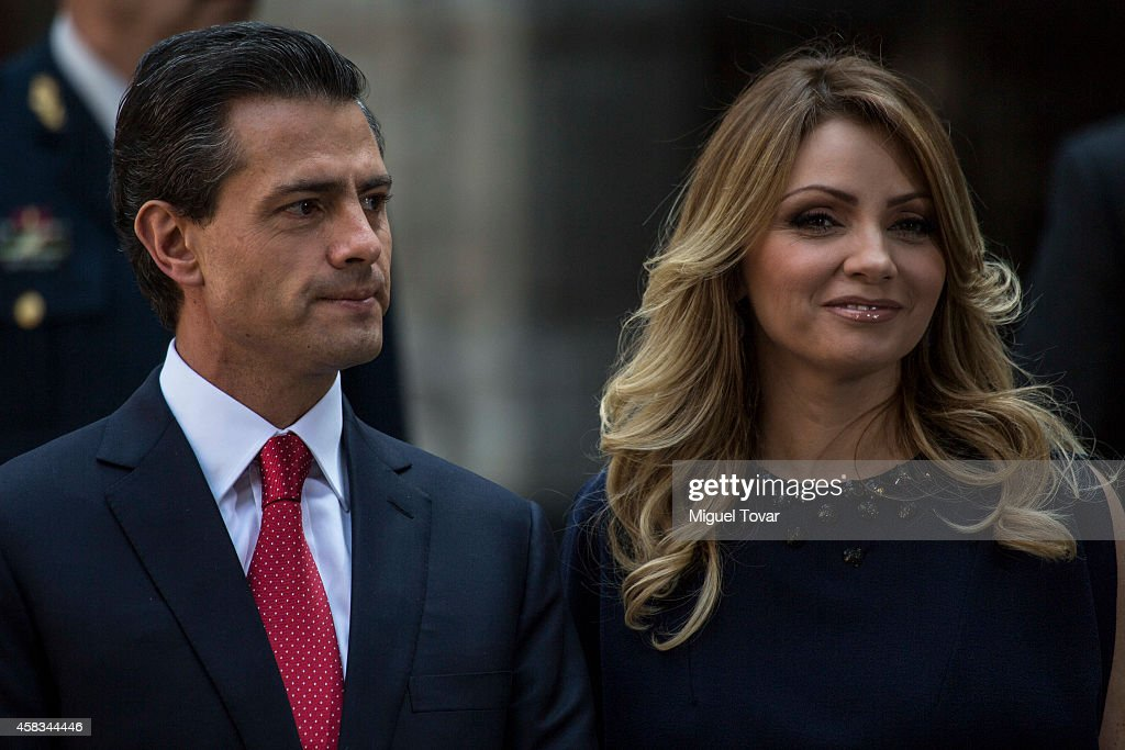 President of Mexico Enrique Peñ–a Nieto (L) and first lady Angelica Rivero (R) await the arrival of Charles Prince of Wales and Camilla, Duchess of Cornwall during an official meeting at Nacional Palace on November 03, 2014 in Mexico City, Mexico.