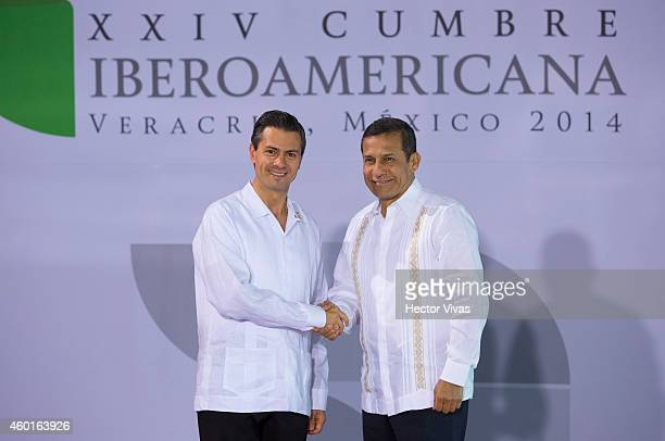 President of Mexico Enrique Peñ–a Nieto salute President of Peru Ollanta Humala during the XXIV IberoAmerican Summit Veracruz 2014 at World Trade...