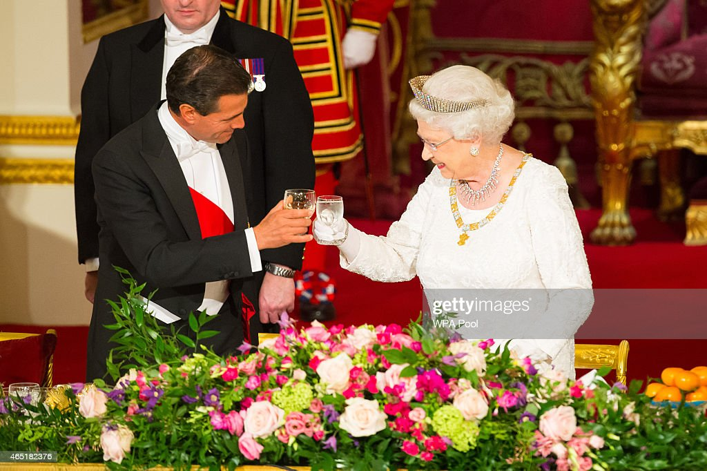 President of Mexico Enrique Pena Nieto and Queen Elizabeth II make a toast during a state banquet at Buckingham Palace on March 3, 2015 in London, England. The President of Mexico, accompanied by Senora Angelica Rivera de Pena, are on a State Visit to the United Kingdom as the guests of Her Majesty The Queen from Tuesday 3rd March to Thursday 5th March.