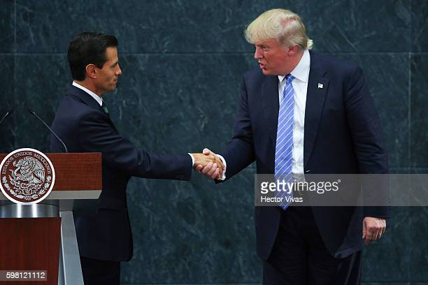 President of Mexico Enrique Pena Nieto greets US Republican presidential candidate Donald Trump during a meeting at Los Pinos on August 31 2016 in...