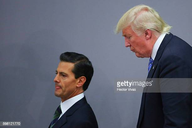 President of Mexico Enrique Pena Nieto walks along US Republican presidential candidate Donald Trump after a meeting at Los Pinos on August 31 2016...