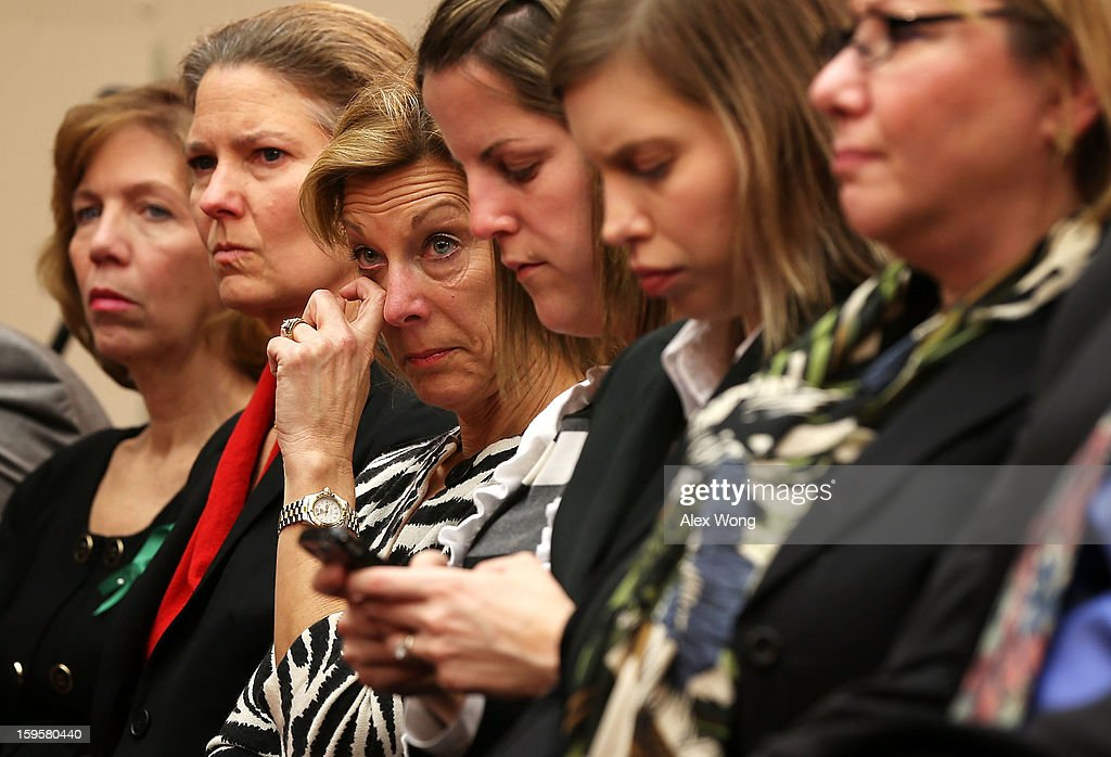 President of Million Mom March Martina Leinz (3rd L) wipes a tear as she listens to testimony of Superintendent of schools of Newtown, Connecticut, Janet Robinson about the shooting of Sandy Hook Elementary during a hearing before the House Democratic Steering and Policy Committee January 16, 2013 on Capitol Hill in Washington, DC. The committee held a hearing to focus on gun violence prevention.
