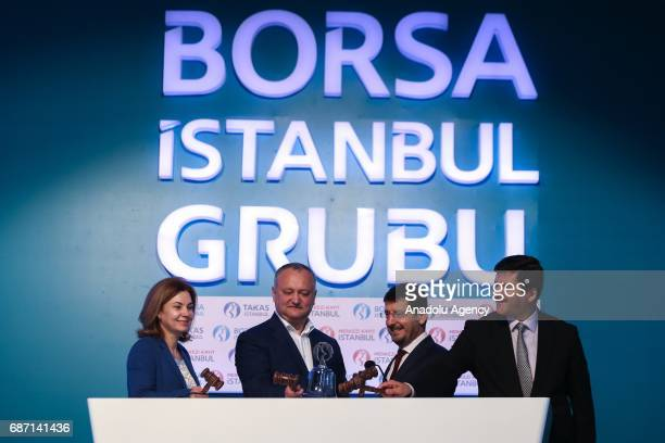 President of Moldova Igor Dodon and Chairman of the Borsa Istanbul Himmet Karadag hit a bell during a ceremony at Borsa Istanbul in Istanbul Turkey...