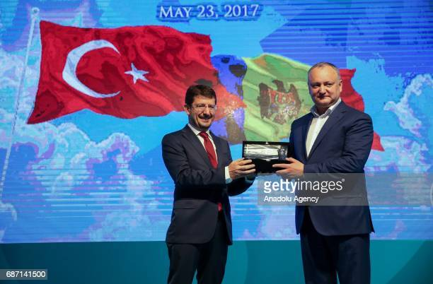 President of Moldova Igor Dodon receives a gift from Chairman of the Borsa Istanbul Himmet Karadag during a ceremony at Borsa Istanbul in Istanbul...
