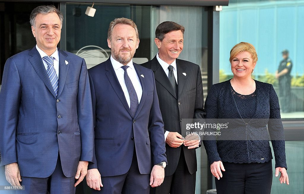 President of Montenegro Filip Vujanovic, Member of the Tripartite Bosnian Presidency Bakir Izetbegovic, President of Slovenia Borut Pahor, Croatian President Kolinda Grabar-Kitarovic pose at Bosnia and Herzegovina's National Assembly in Sarajevo, on May 29, 2016. Heads of western Balkan nations meet for an annual summit during which they will discuss regional cooperation. / AFP / ELVIS