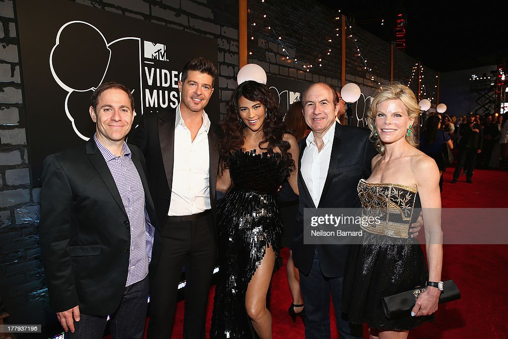 President of MTV Stephen Friedman, singer <a gi-track='captionPersonalityLinkClicked' href=/galleries/search?phrase=Robin+Thicke&family=editorial&specificpeople=724390 ng-click='$event.stopPropagation()'>Robin Thicke</a>, actress <a gi-track='captionPersonalityLinkClicked' href=/galleries/search?phrase=Paula+Patton&family=editorial&specificpeople=752812 ng-click='$event.stopPropagation()'>Paula Patton</a>, Viacom President and CEO <a gi-track='captionPersonalityLinkClicked' href=/galleries/search?phrase=Philippe+Dauman&family=editorial&specificpeople=1381252 ng-click='$event.stopPropagation()'>Philippe Dauman</a> and Deborah Dauman attend the 2013 MTV Video Music Awards at the Barclays Center on August 25, 2013 in the Brooklyn borough of New York City.