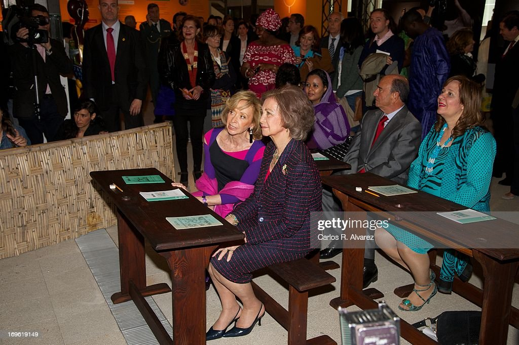 President of 'Mujeres por Africa' Foundation <a gi-track='captionPersonalityLinkClicked' href=/galleries/search?phrase=Maria+Teresa+Fernandez+de+la+Vega&family=editorial&specificpeople=841674 ng-click='$event.stopPropagation()'>Maria Teresa Fernandez de la Vega</a> (L) and <a gi-track='captionPersonalityLinkClicked' href=/galleries/search?phrase=Queen+Sofia+of+Spain&family=editorial&specificpeople=160333 ng-click='$event.stopPropagation()'>Queen Sofia of Spain</a> (R) attend the 'Mujeres Por Africa' exhibition at the COAM on May 29, 2013 in Madrid, Spain.