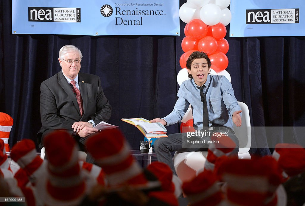 President of National Education Association Dennis Van Roekel and actor <a gi-track='captionPersonalityLinkClicked' href=/galleries/search?phrase=Jake+T.+Austin&family=editorial&specificpeople=709221 ng-click='$event.stopPropagation()'>Jake T. Austin</a> read onstage at NEA's Read Across America Day at New York Public Library on March 1, 2013 in New York City.