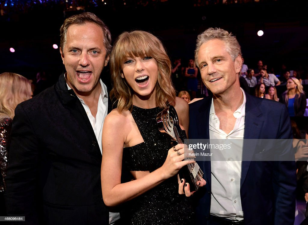 President of National Programming Platforms for iHeartMedia Tom Poleman recording artist Taylor Swift winner of the Artist of the Year Award Song of...