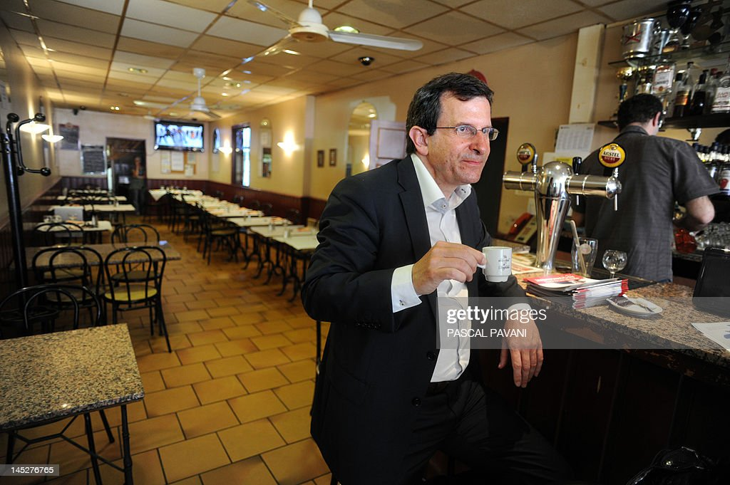President of National Union of Students of France - Independent and Democratic (UNEF-ID) and Socialist Party (PS) candidate in the 9th constituency of Haute-Garonne for French parliamentary election, Christophe Borgel, drinks a coffee in a bar on May 25, 2012 in Toulouse, southwestern France, following a distribution of campaign leaflets as he met with inhabitants on a market as part of his campaign.