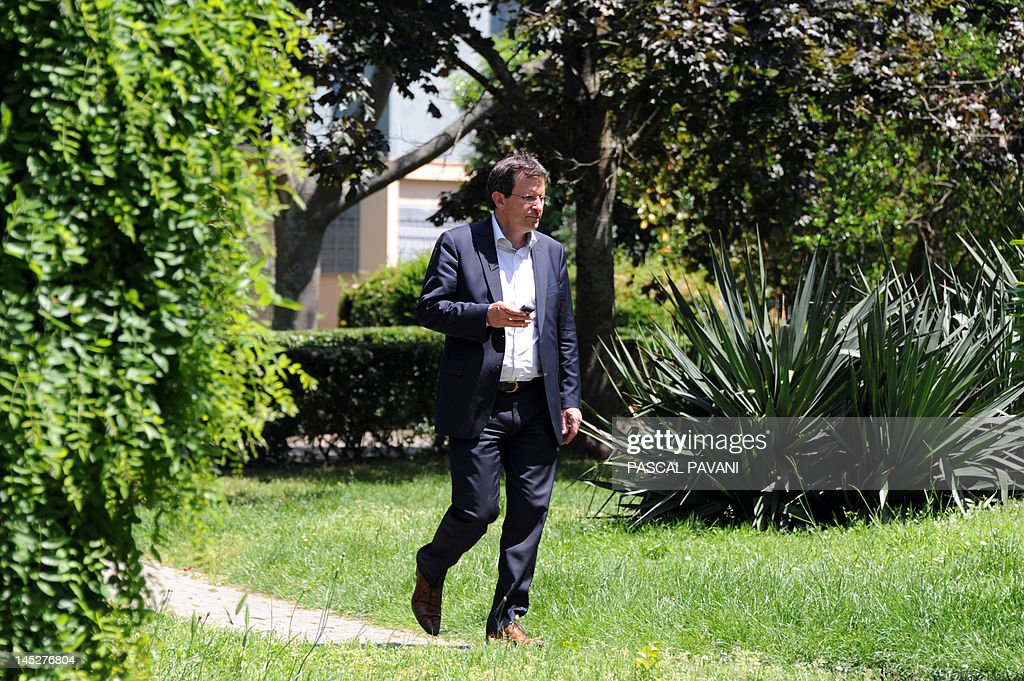 President of National Union of Students of France - Independent and Democratic (UNEF-ID) and Socialist Party (PS) candidate in the 9th constituency of Haute-Garonne for French parliamentary election, Christophe Borgel, walks in a garden during a campaign visit on May 25, 2012 in Toulouse, southwestern France, following a distribution of campaign leaflets as he met with inhabitants on a market.