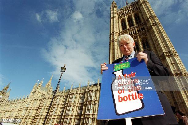 President of NFU Wales Hugh Richards holds a placard in support of Dairy farmers outside the Houses of Parliament London as part of the National...