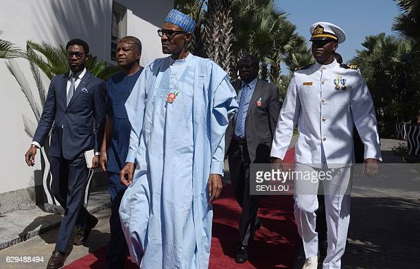 President of Nigeria Muhammadu Buhari arrives at a hotel in Banjul on December 13 for a meeting with regional West African leaders in a bid to...