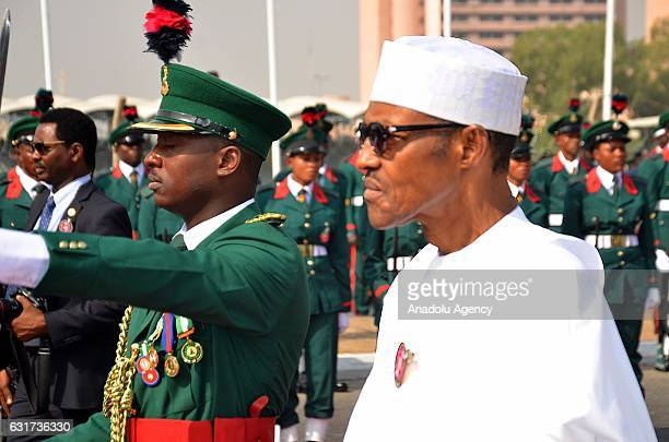 President of Nigeria Muhammadu Buhari attends Armed Forces Day military parade at unknown soldier monument in Abuja Nigeria on January 15 2017