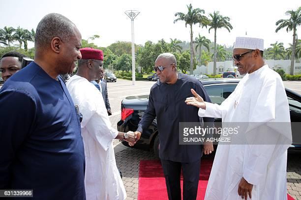 President of Nigeria Muhammadu Buhari greets former President of Ghana John Mahama in Abuja on January 9 before a meeting on the political situation...