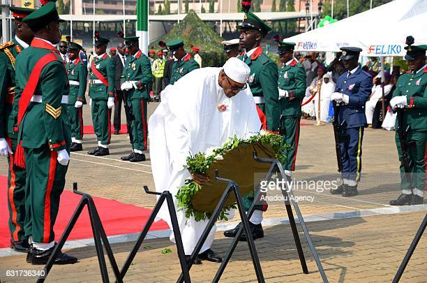 President of Nigeria Muhammadu Buhari lays a wreath in front of unknown soldier monument during Armed Forces Day in Abuja Nigeria on January 15 2017