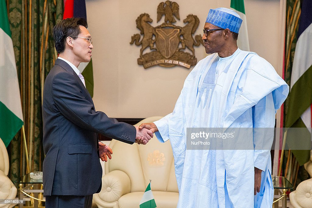 President of Nigeria Muhammadu Buhari receives in farewell audience Gu Xiaojie, Outgoing Ambassador of Peoples Republic of China to Nigeria in Abuja, Nigeria, on May 25, 2016.