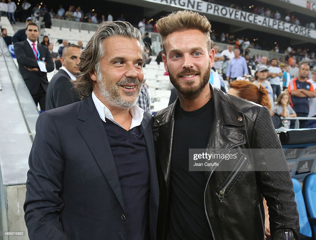 President of OM Vincent Labrune greets Matt Pokora during the French Ligue 1 match between Olympique de Marseille (OM) and Troyes ESTAC at New Stade Velodrome on August 23, 2015 in Marseille, France.