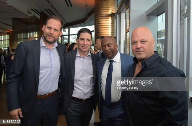 FX president of original programming Nick Grad FX president of original programming Eric Schrier John Singleton and Michael Chiklis attend FX...