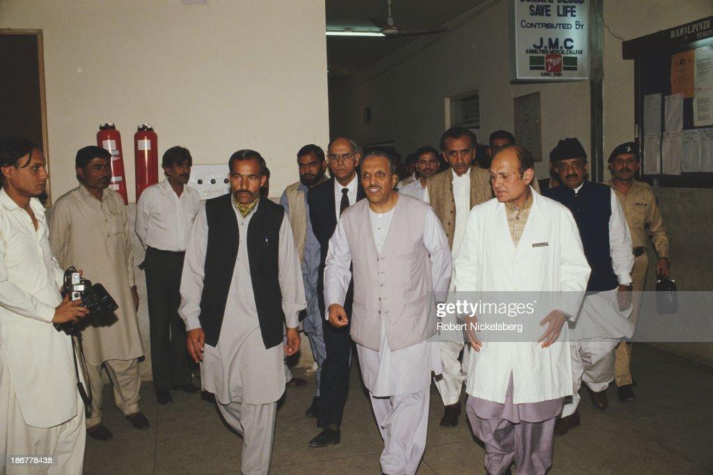 President of Pakistan Muhammad ZiaulHaq visits injured survivors of the Ojhri Camp explosion in hospital Rawalpindi Pakistan April 1988