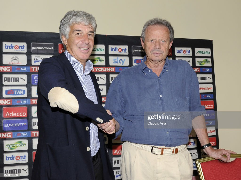 President of Palermo Maurizio Zamparini poses with new coach <a gi-track='captionPersonalityLinkClicked' href=/galleries/search?phrase=Gian+Piero+Gasperini&family=editorial&specificpeople=4667555 ng-click='$event.stopPropagation()'>Gian Piero Gasperini</a> (L) before his presentation on September 18, 2012 in Milan, Italy.