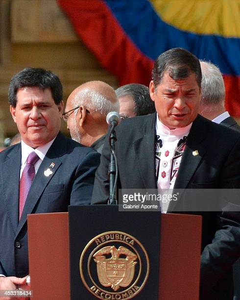 President of Paraguay Horacio Cartes and President of Ecuador Rafael Correa during a ceremony in which Juan Manuel Santos officially takes office as...