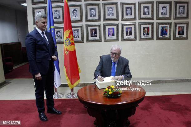 President of Parliamentary Assembly of the Council of Europe Pedro Agramunt signs the guest book as the Speaker of the Montenegrin Parliament Ivan...