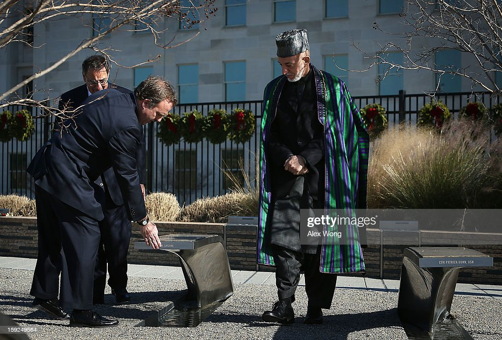 President of Pentagon Memorial Fund James Laychak (2nd R) touches the banch of his brother David Laychak as he and U.S. Secretary of Defense Leon Panetta (L) accompany Afghan President <a gi-track='captionPersonalityLinkClicked' href=/galleries/search?phrase=Hamid+Karzai&family=editorial&specificpeople=121540 ng-click='$event.stopPropagation()'>Hamid Karzai</a> during a visit at the National 9/11 Pentagon Memorial January 10, 2013 in Arlington, Virginia. Karzai is on a visit in Washington, including a meeting with U.S. President Barack Obama at the White House, to discuss the continued transition in Afghanistan and the partnership between the two nations.