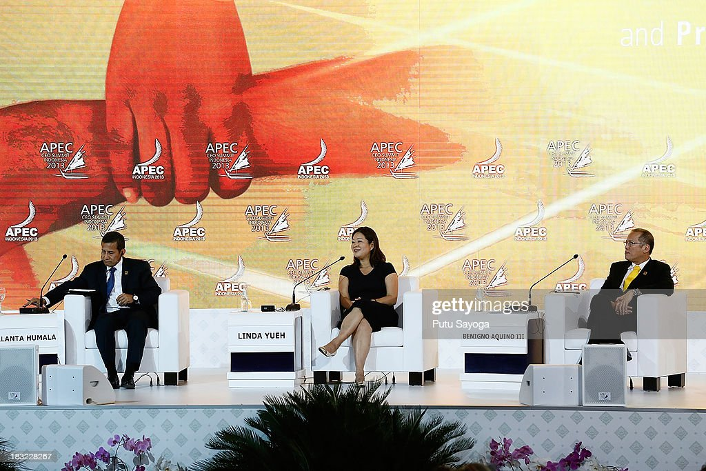 President of Peru Ollanta Humala (L) and President of Philippines Benigno Aquino III (R) attend a discussion panel with business leaders moderated by Chief Business Correspondent BBC, Linda Yueh (C) during the APECCEO Summit on October 6, 2013 in Nusa Dua, Indonesia.