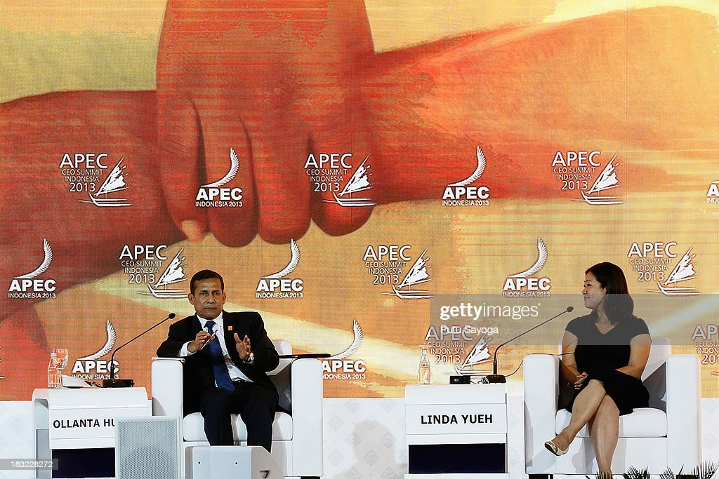 President of Peru Ollanta Humala talks at a discussion panel with business leaders moderated by Chief Business Correspondent BBC, Linda Yueh (R) during the APECCEO Summit on October 6, 2013 in Nusa Dua, Indonesia.