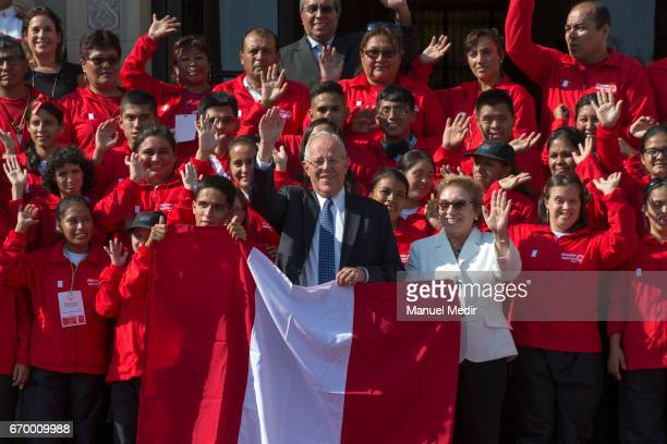 President of Peru Pedro Pablo Kuczynski and Minister of Women and Vulnerable Populations Ana Maria Romero pose with the Delegation of 33 Peruvian...