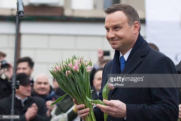 President of Poland Andrzej Duda hands flowers to women during the Women's Day on 08 March 2016 in Otwock Poland