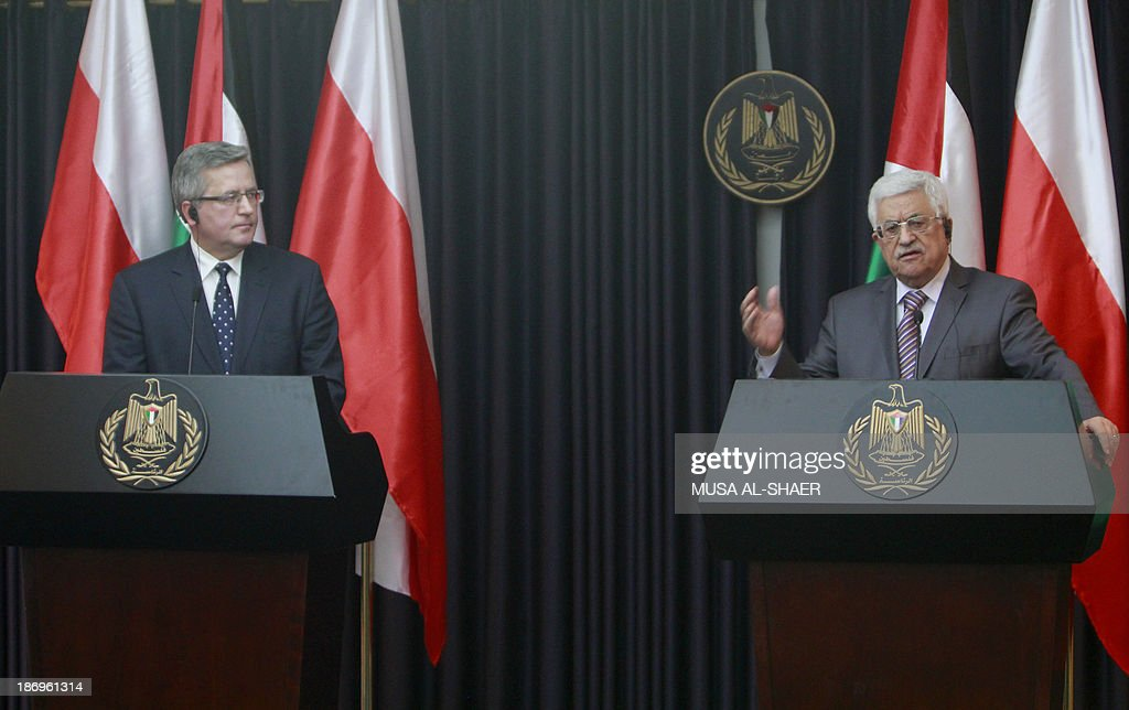 President of Poland Bronislaw Komorowski (L) attends a press conference with Palestinian Authority president Mahmud Abbas, in the West Bank city of Bethlehem, on November 5, 2013.