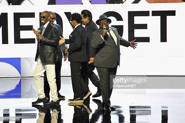 President of programming Stephen G Hill and comedians Charlie Murphy DL Hughley George Lopez and Cedric the Entertainer speak onstage during BET...
