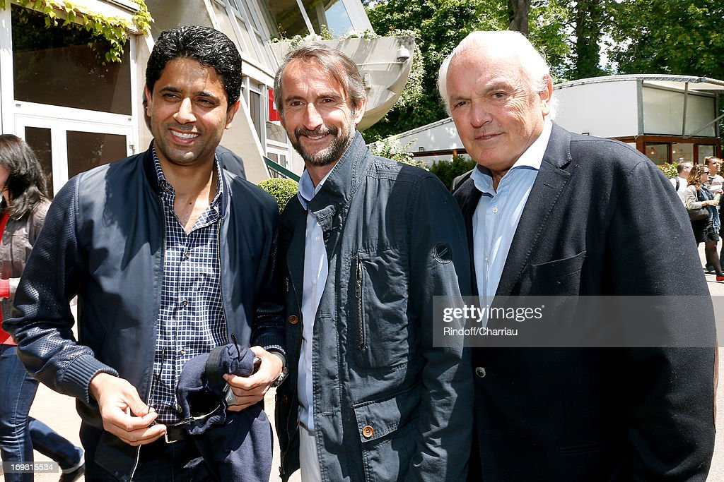 President of PSG football team Nasser Al Khelaifi, Chief Operating Officer of PSG football team Jean-Claude Blanc and <a gi-track='captionPersonalityLinkClicked' href=/galleries/search?phrase=Christian+Bimes&family=editorial&specificpeople=586717 ng-click='$event.stopPropagation()'>Christian Bimes</a> attend Roland Garros Tennis French Open 2013 - Day 8 on June 2, 2013 in Paris, France.