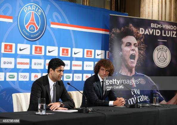 President of PSG Nasser AlKhelaifi and David Luiz of Paris SaintGermain answer to the media during the Brazilian official presentation after signing...