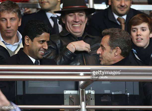 President of PSG Nasser AlKhelaifi and former French President Nicolas Sarkozy attend the Ligue 1 match between Paris SaintGermain FC and AS...