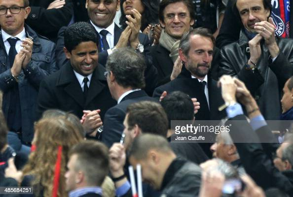 President of PSG Nasser AlKhelaifi congratulates coach of PSG Laurent Blanc while director of PSG JeanClaude Blanc looks on at the end of the French...