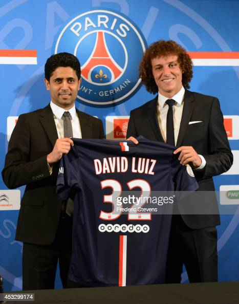 President of PSG Nasser AlKhelaifi presents to David Luiz his new jersey during the Brazilian official presentation after signing for PSG at The...