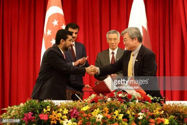 President of Qatar University Dr Hassan Rashid Al Derham and Vice President National University of Singapore Professor Philip LiFan Liu shake hands...