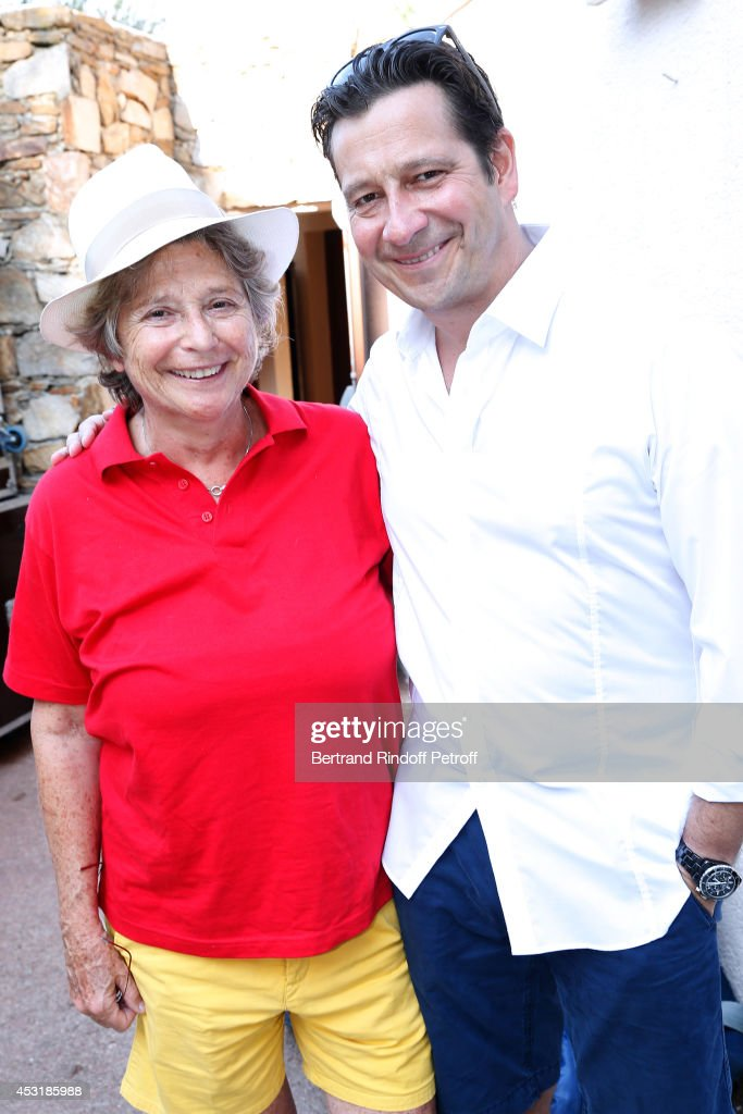President of Ramatuelle Festival Jacqueline Franjou and French impersonator <a gi-track='captionPersonalityLinkClicked' href=/galleries/search?phrase=Laurent+Gerra&family=editorial&specificpeople=538435 ng-click='$event.stopPropagation()'>Laurent Gerra</a> attend the 30th Ramatuelle Festival : Day 4 on August 4, 2014 in Ramatuelle, France.