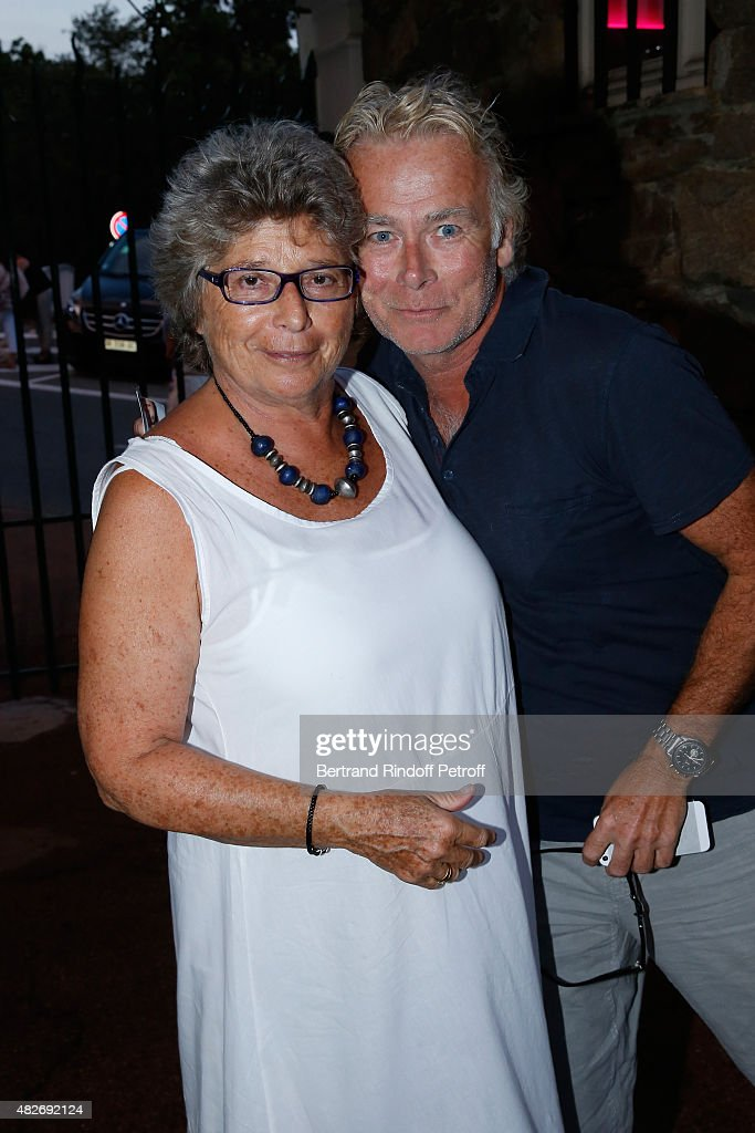 President of Ramatuelle Festival Jacqueline Franjou and Humorist <a gi-track='captionPersonalityLinkClicked' href=/galleries/search?phrase=Franck+Dubosc&family=editorial&specificpeople=609327 ng-click='$event.stopPropagation()'>Franck Dubosc</a> attend the 'Madame Foresti' show of Humorist Florence Foresti during the 31th Ramatuelle Festival : Day 1 on August 1, 2015 in Ramatuelle, France.