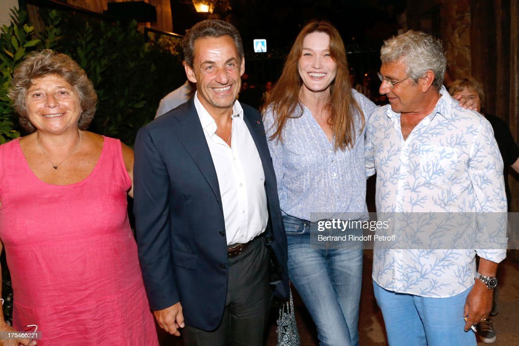 President of Ramatuelle Festival Jacqueline Franjou, Former French President <a gi-track='captionPersonalityLinkClicked' href=/galleries/search?phrase=Nicolas+Sarkozy&family=editorial&specificpeople=211375 ng-click='$event.stopPropagation()'>Nicolas Sarkozy</a> with his wife singer <a gi-track='captionPersonalityLinkClicked' href=/galleries/search?phrase=Carla+Bruni&family=editorial&specificpeople=235729 ng-click='$event.stopPropagation()'>Carla Bruni</a> and Artistic Director of the Festival <a gi-track='captionPersonalityLinkClicked' href=/galleries/search?phrase=Michel+Boujenah&family=editorial&specificpeople=1027167 ng-click='$event.stopPropagation()'>Michel Boujenah</a> attend 'Pianistic' Concert of singer Julien Clerc at at 29th Ramatuelle Festival : Day 4 on August 3, 2013 in Ramatuelle, France.