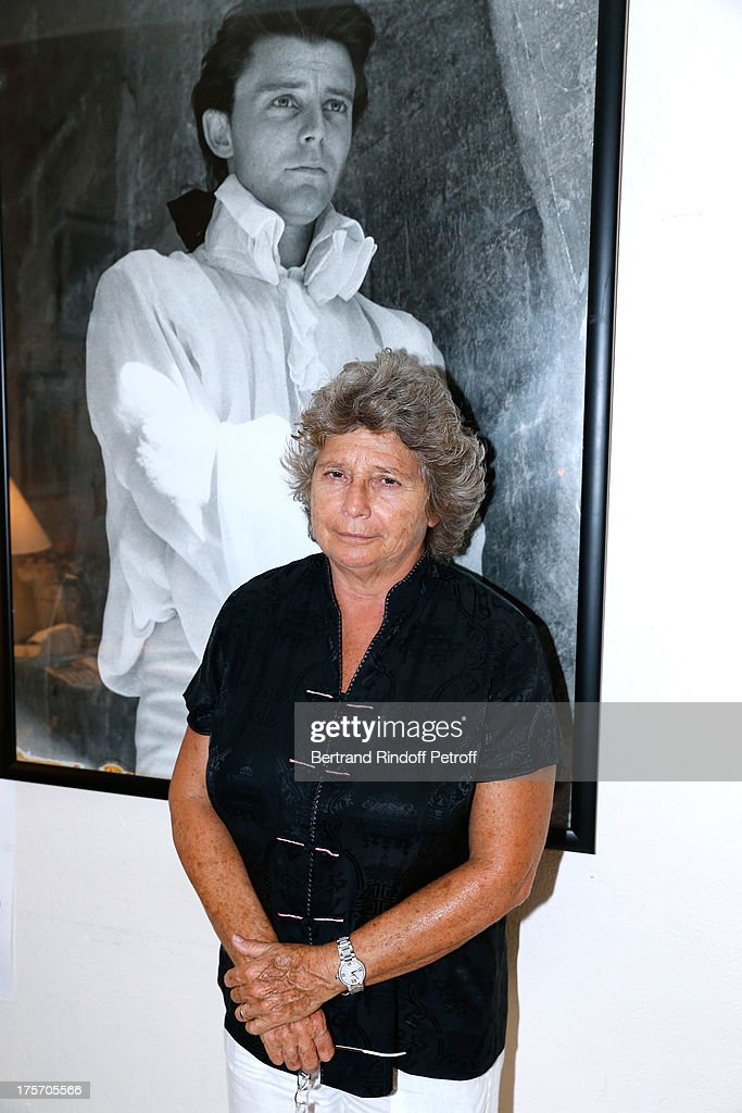 President of Ramatuelle Festival Jacqueline Franjou poses in front of a picture of actor Gerard Philipe at Magician Eric Antoine's show, 'Le mix sous les etoiles' on day 7 of the 29th Ramatuelle Festival on August 6, 2013 in Ramatuelle, France.