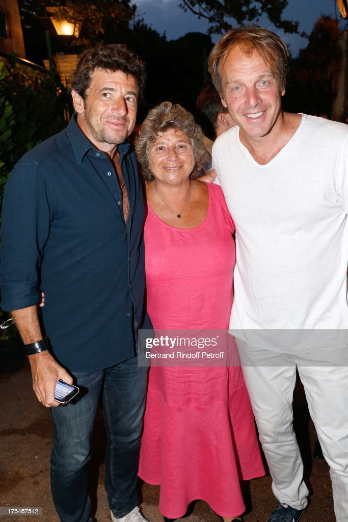 President of Ramatuelle Festival Jacqueline Franjou stands between singer <a gi-track='captionPersonalityLinkClicked' href=/galleries/search?phrase=Patrick+Bruel&family=editorial&specificpeople=549816 ng-click='$event.stopPropagation()'>Patrick Bruel</a> (L) and Herve Taieb 'Pianistic' Concert of singer Julien Clerc at at 29th Ramatuelle Festival : Day 4 on August 3, 2013 in Ramatuelle, France.