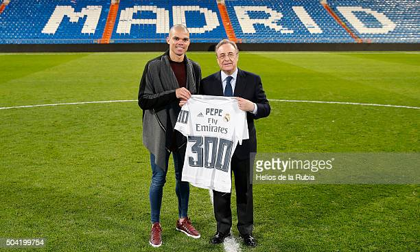 President of Real Madrid delivers a Florentine shirt the player Pepe for his 300 games with Real Madrid the La Liga match between Real Madrid CF and...